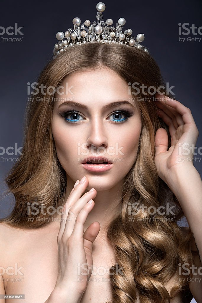 Beautiful girl with a crown in the form of princess. stock photo