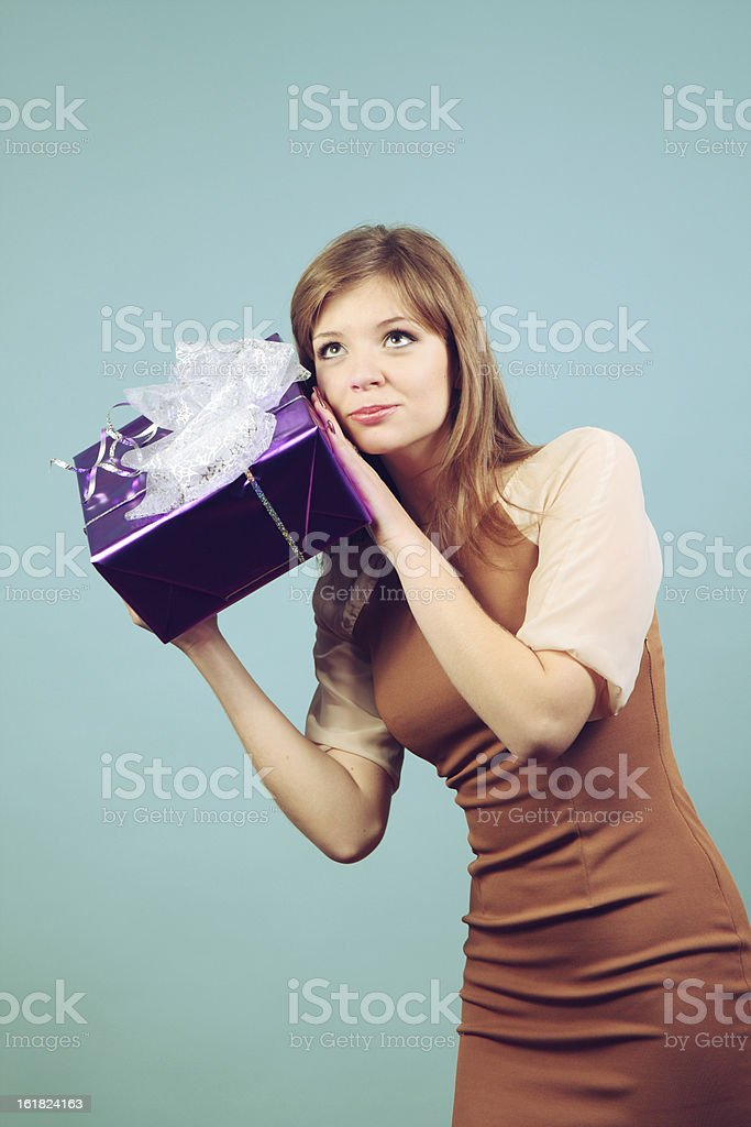 Beautiful girl with a gift. royalty-free stock photo