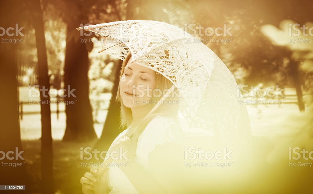 Beautiful girl with a parasol - vintage stock photo