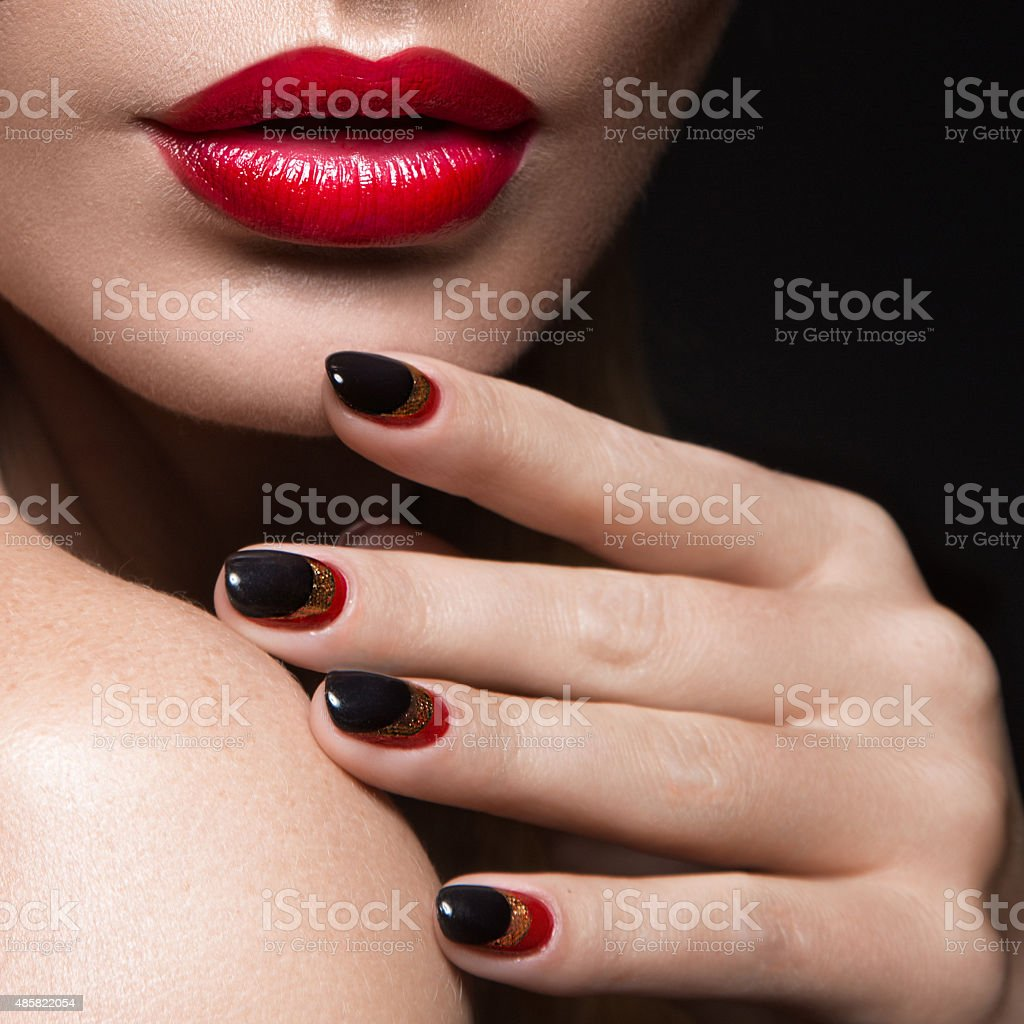 Beautiful girl with a veil, evening makeup, black and red stock photo