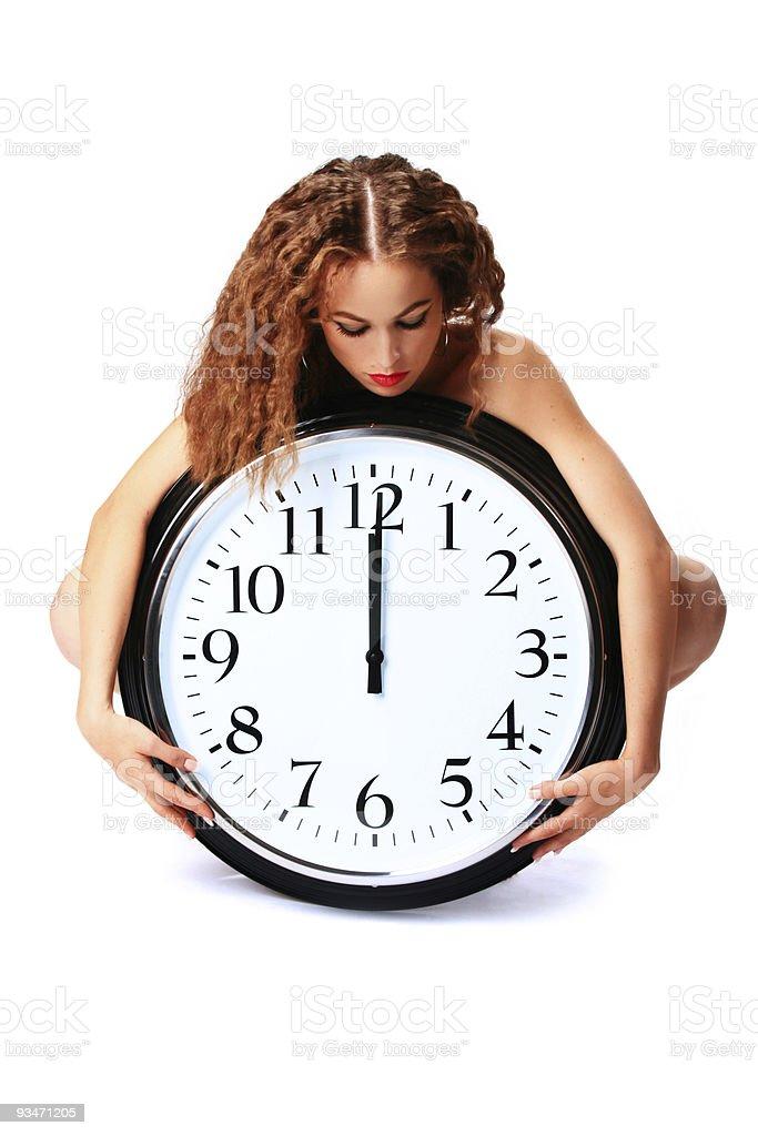 beautiful girl with a wall clock stock photo