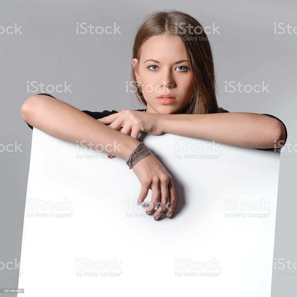 beautiful girl with a white poster for your text stock photo