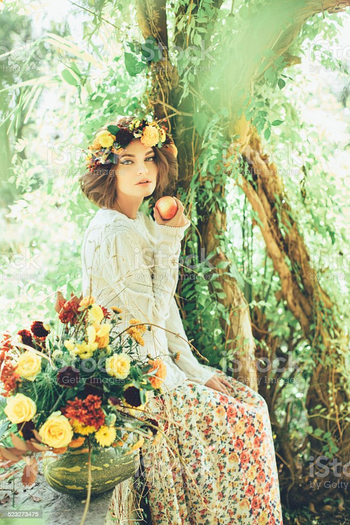 Beautiful girl with a wreath on her head stock photo