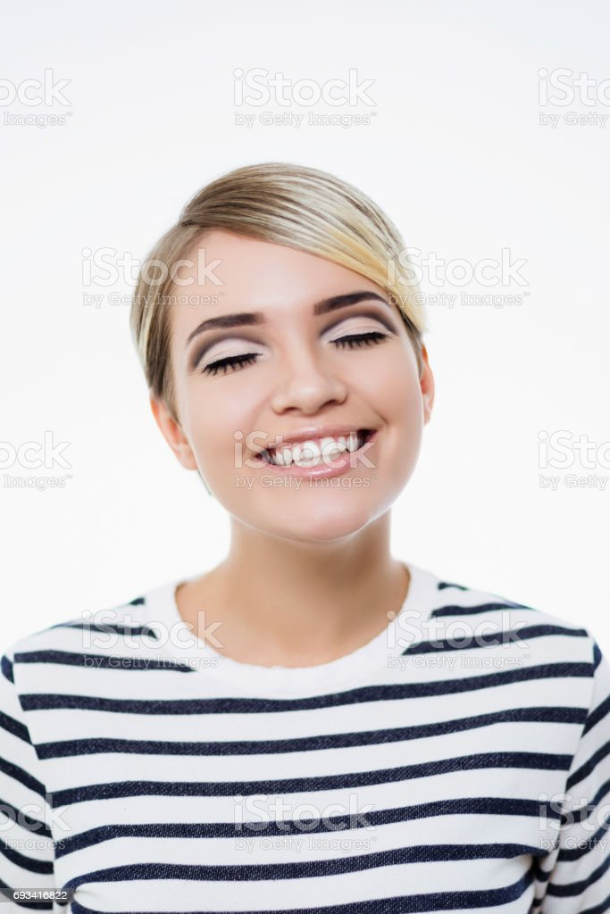 beautiful girl with an unusual make-up posing in studio stock photo