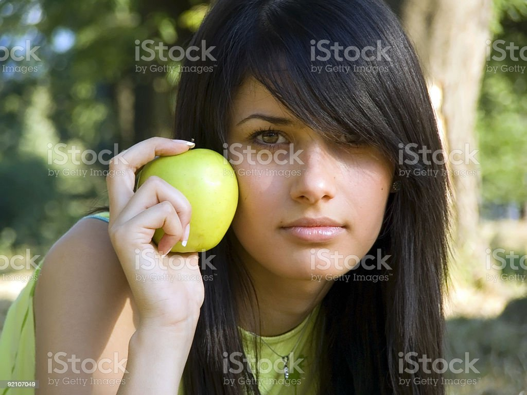 beautiful girl with apple royalty-free stock photo