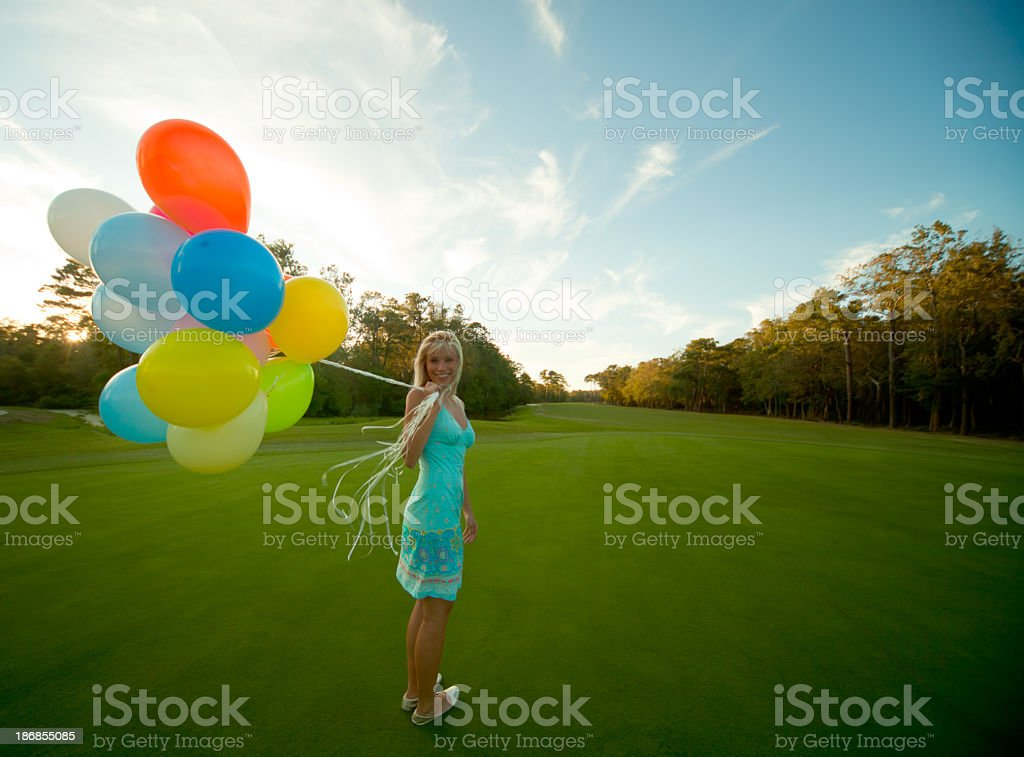 Beautiful girl with balloons stock photo