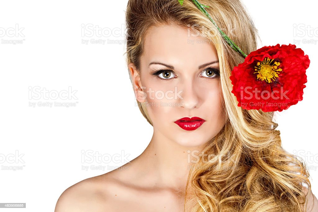 Beautiful girl with blond hair and red flower stock photo