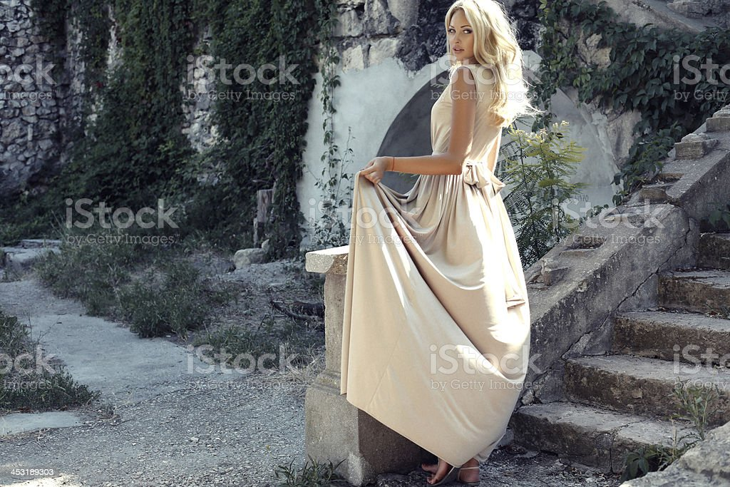 beautiful girl with blond hair in park royalty-free stock photo