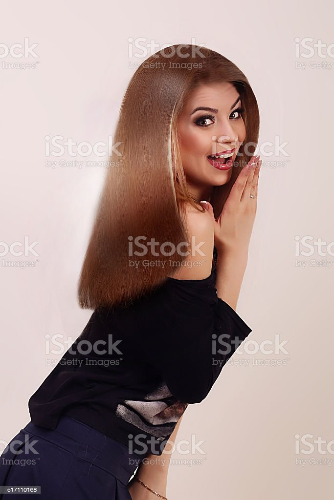 Beautiful girl with brown hair . Long straight hair royalty-free stock photo