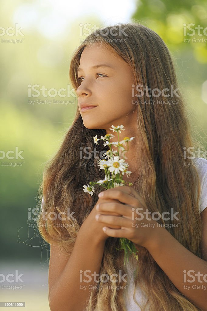 beautiful girl with camomiles in hands royalty-free stock photo