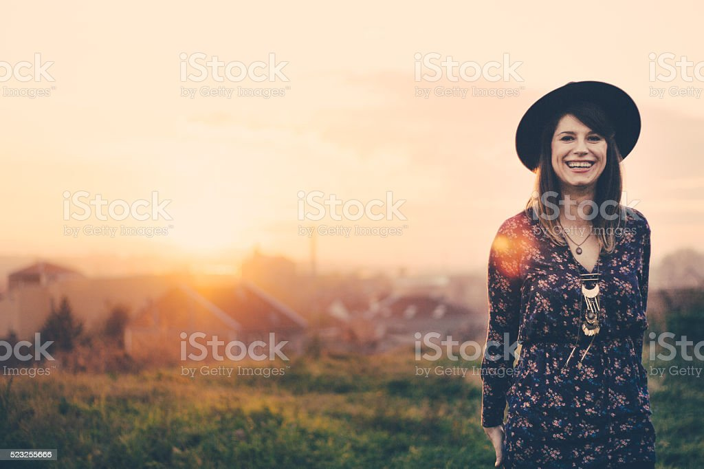 Beautiful girl with charming smile posing in wondreful viewport stock photo