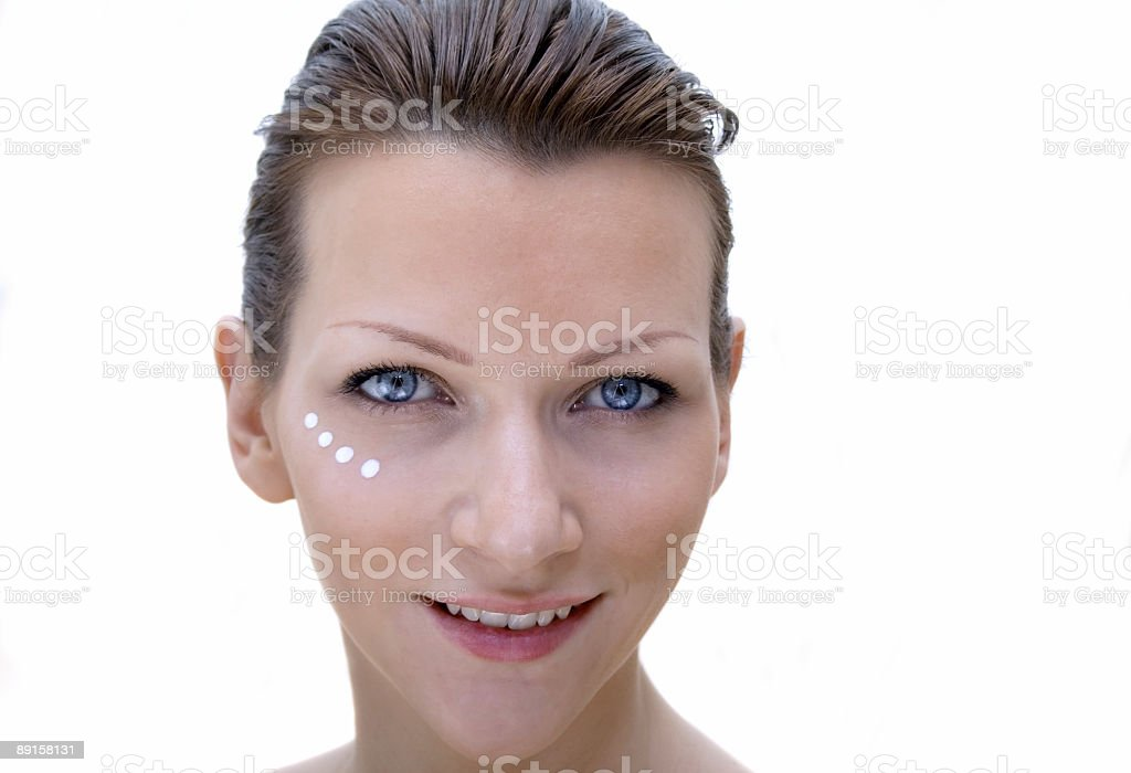 Beautiful girl with creme on her face stock photo