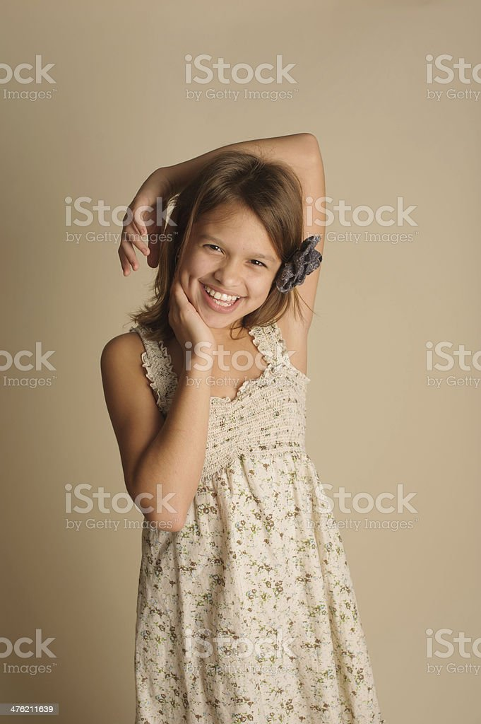 Beautiful Girl with Dimples Posing for the Camera royalty-free stock photo