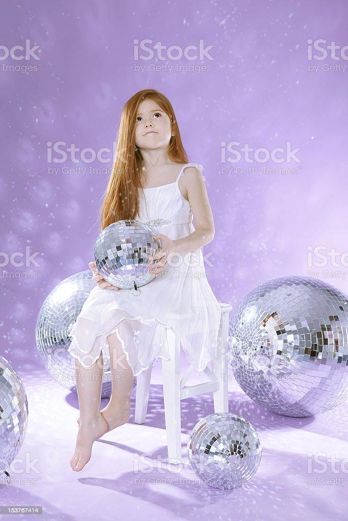 Beautiful girl with disco balls royalty-free stock photo