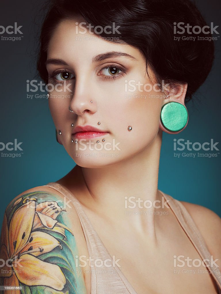 Beautiful girl with face piercing and tattoo royalty-free stock photo