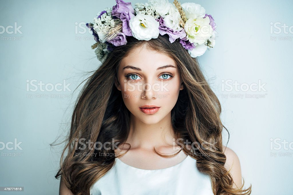 Beautiful girl with flower wreath stock photo