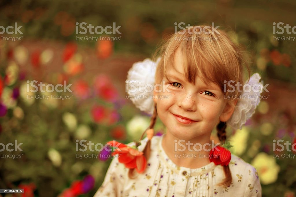 Beautiful girl with flowers in her hair stock photo