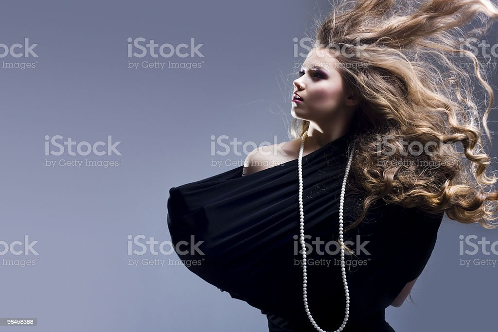 Beautiful girl with flying blond hair royalty-free stock photo
