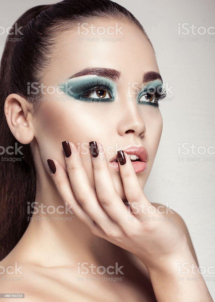 beautiful girl with green smokey eyes make up stock photo