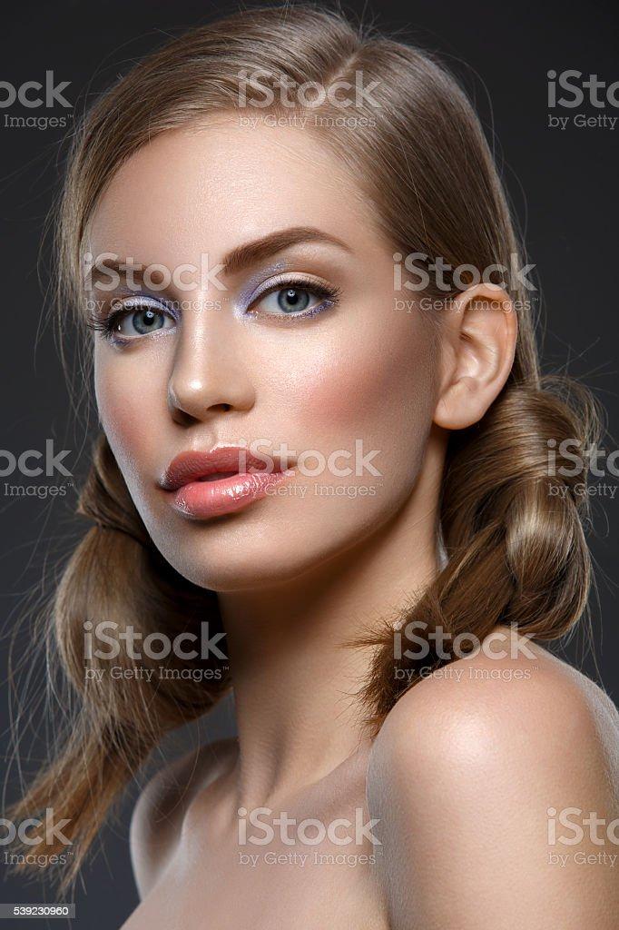 Beautiful girl with hair nods stock photo