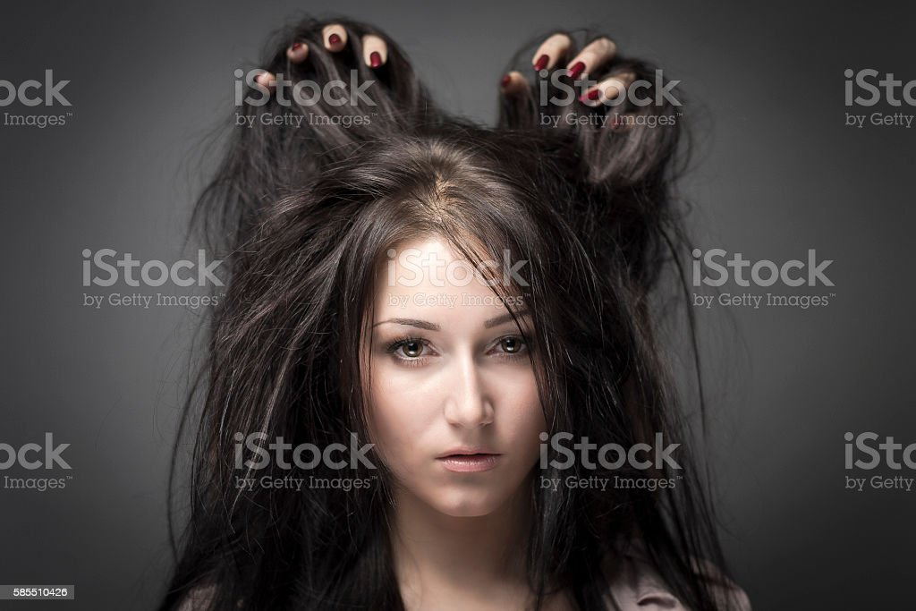 beautiful girl with hands in hair stock photo