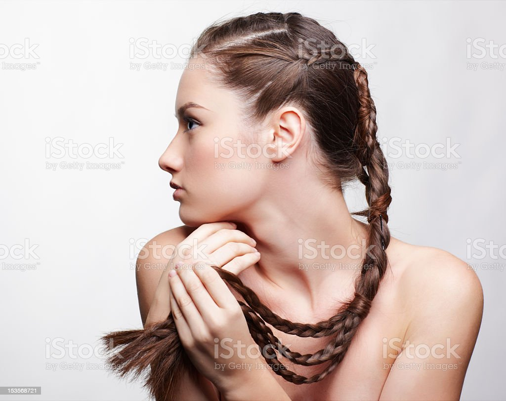 Beautiful girl with her neat and fashioned hair braid royalty-free stock photo