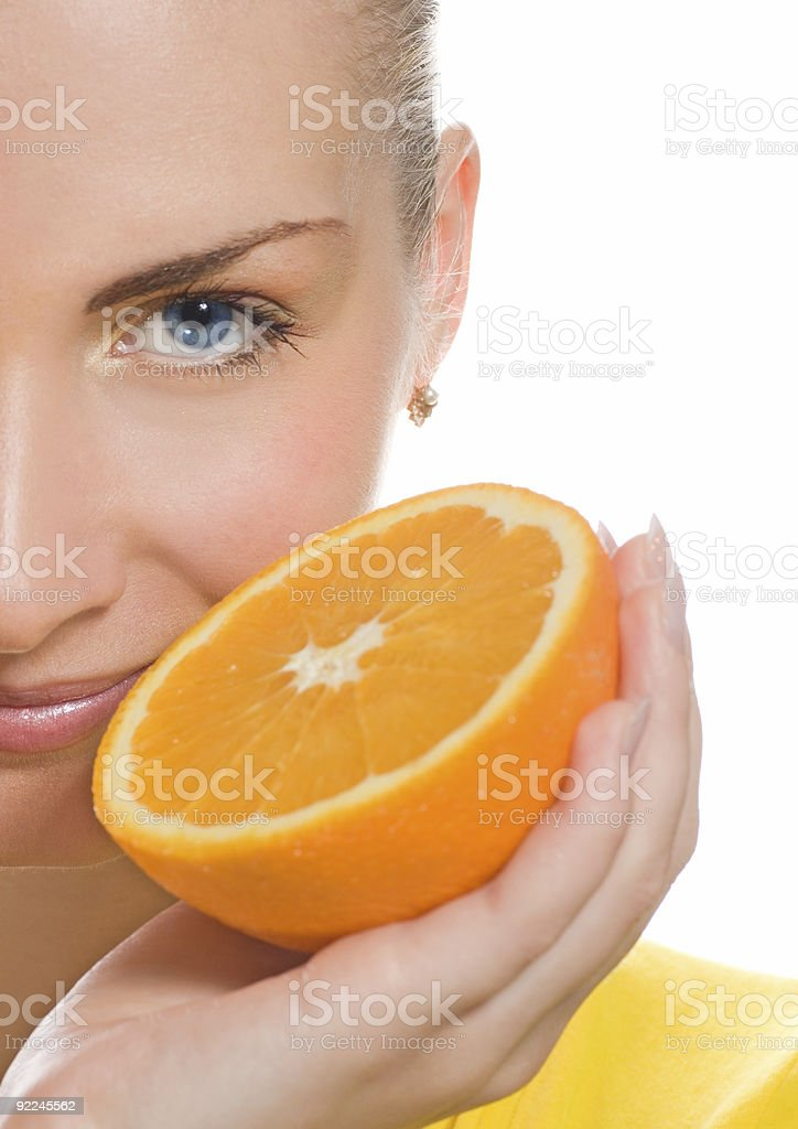 Beautiful girl with juicy orange royalty-free stock photo