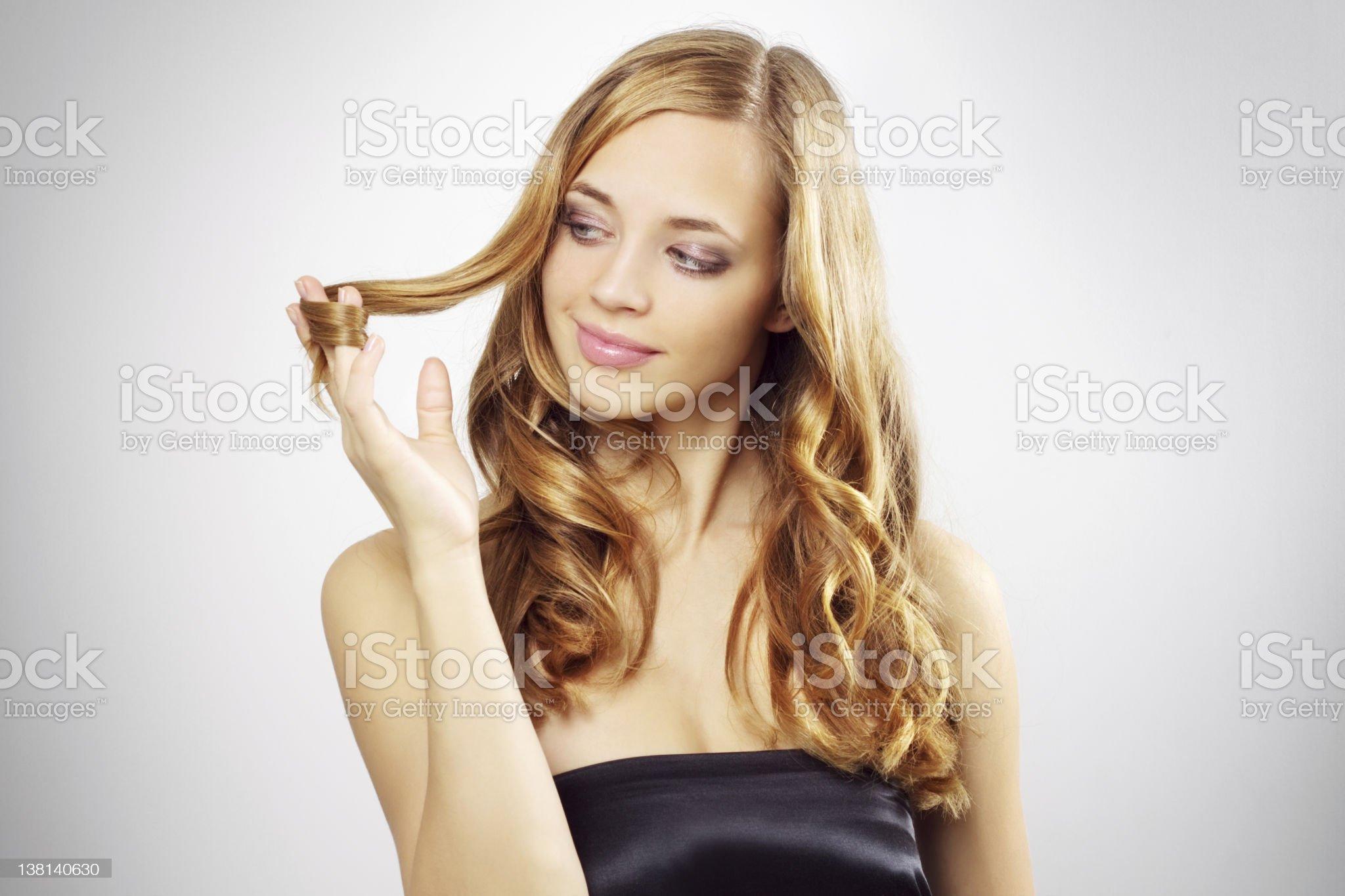 Beautiful girl with long wavy hair royalty-free stock photo