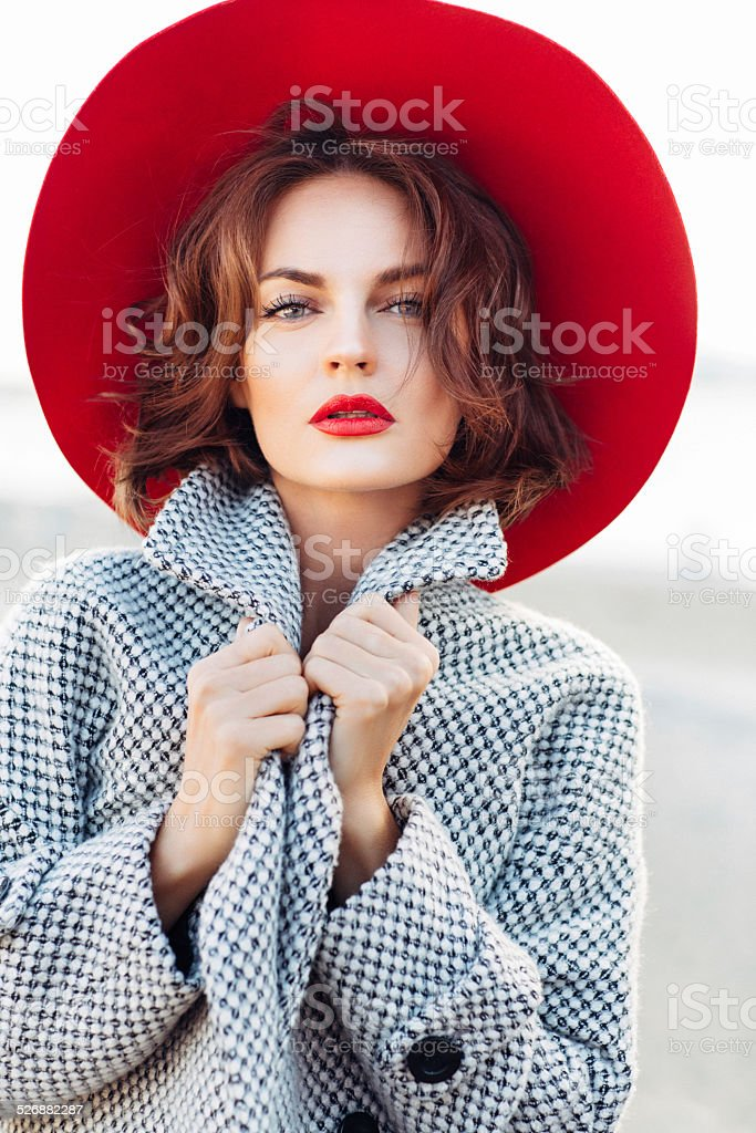 Beautiful girl with make-up and red hat stock photo