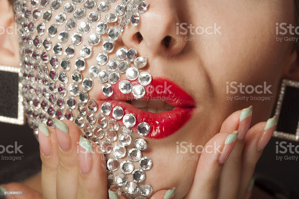Beautiful girl with makeup with crystals stock photo