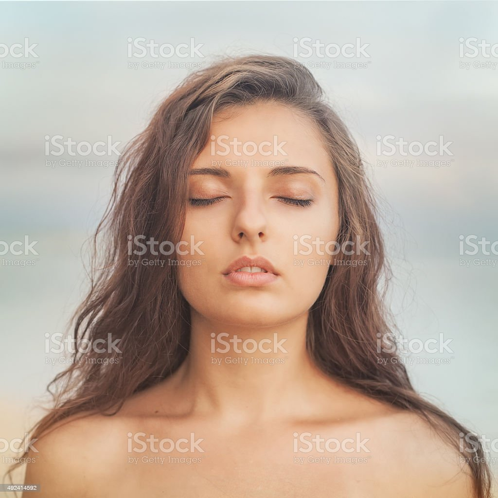 Beautiful girl with naked shoulders stock photo