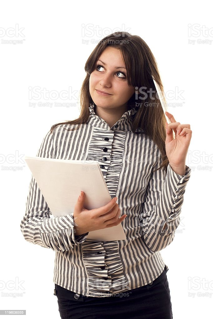 Beautiful girl with pencil and paper thinking about something stock photo