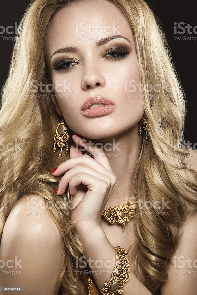 Beautiful girl with perfect skin and evening makeup stock photo