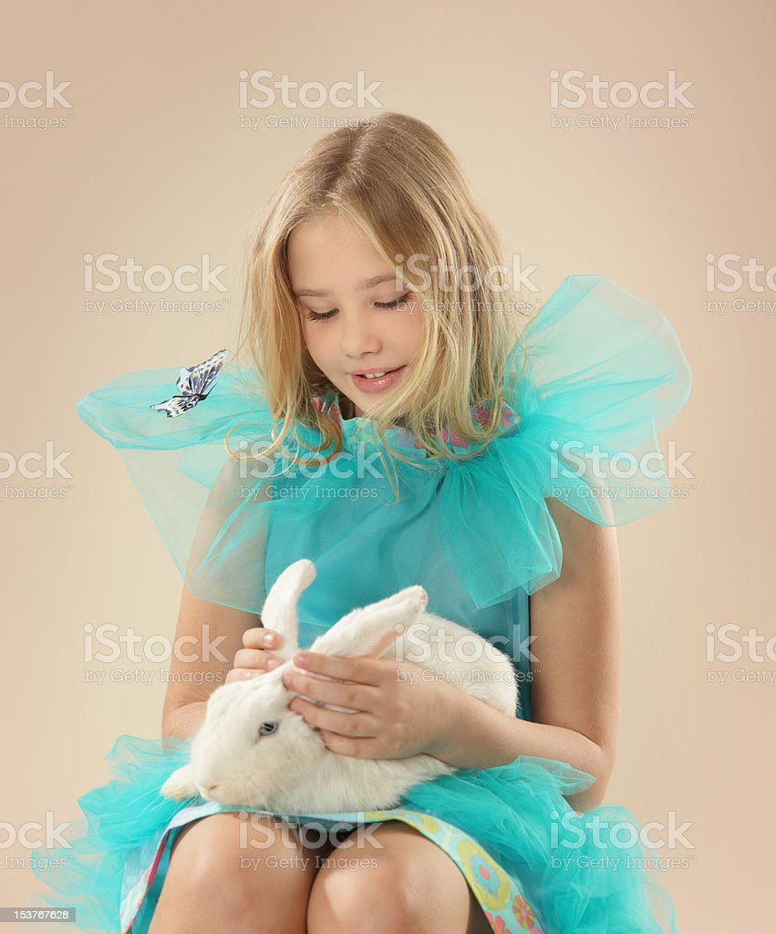 Beautiful girl with rabbit royalty-free stock photo