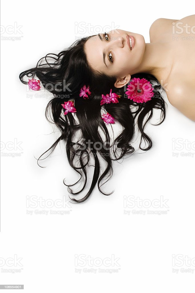 beautiful girl with red flower on black hair royalty-free stock photo