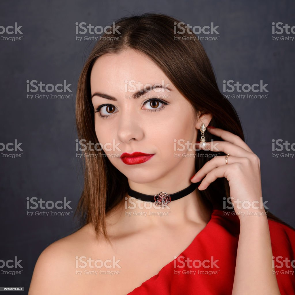Beautiful girl with red lips in dress stock photo