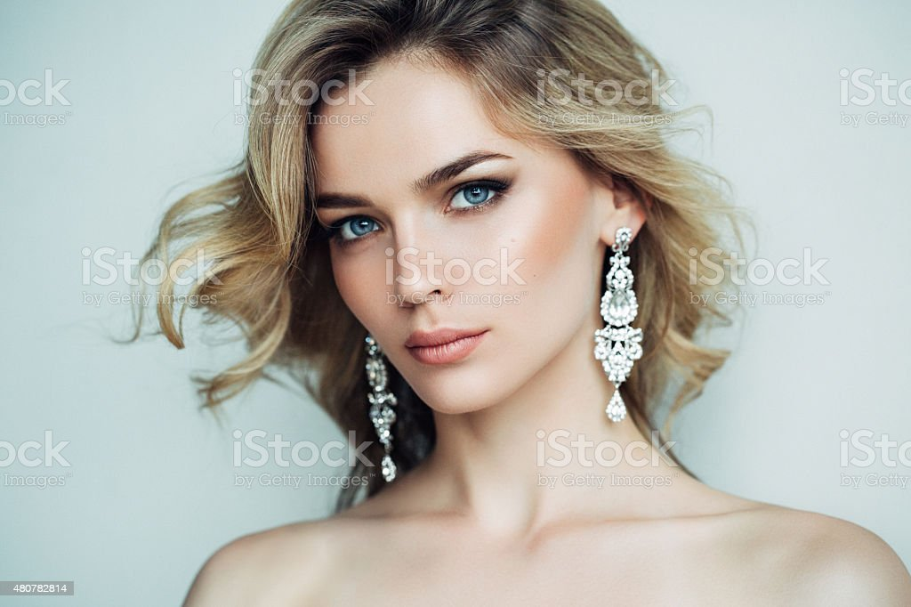 Beautiful girl with shiny earrings stock photo