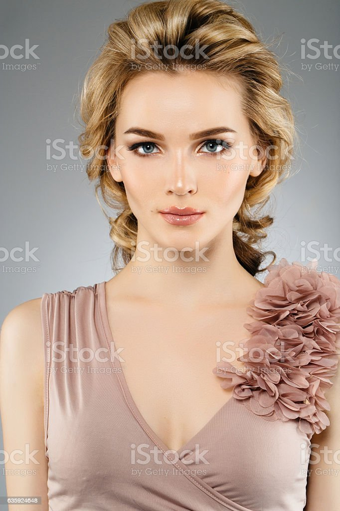 Beautiful girl with shiny earrings stock photo