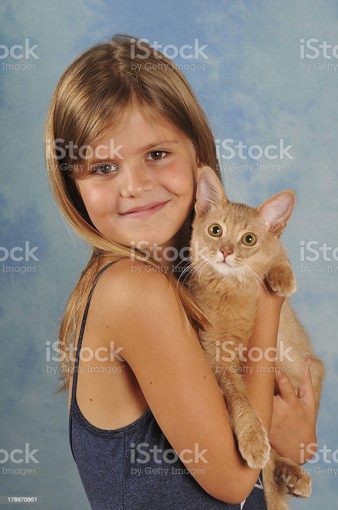 Beautiful girl with somali kitten portrait stock photo