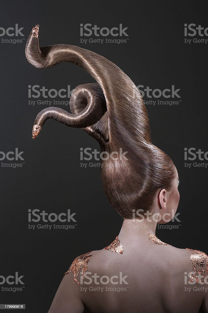 Beautiful girl with strange haircut in style of evil royalty-free stock photo