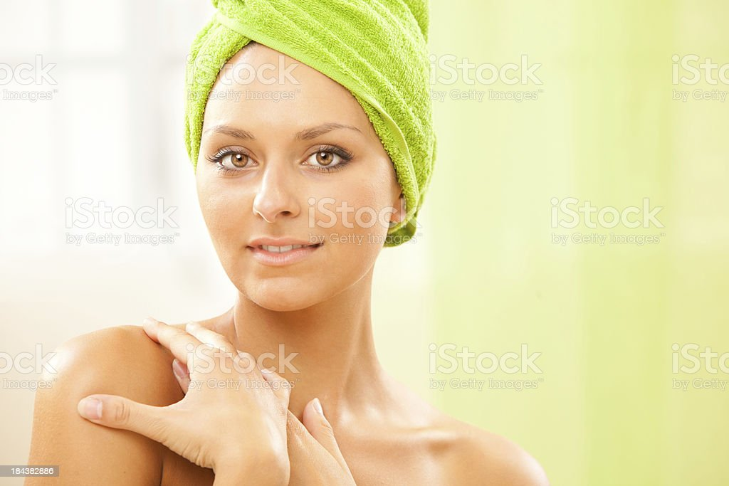 beautiful girl with towel at health spa stock photo