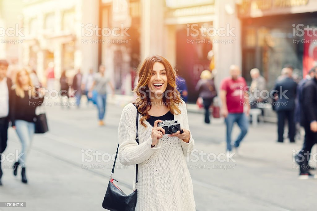 Beautiful girl with vintage camera in Istanbul stock photo