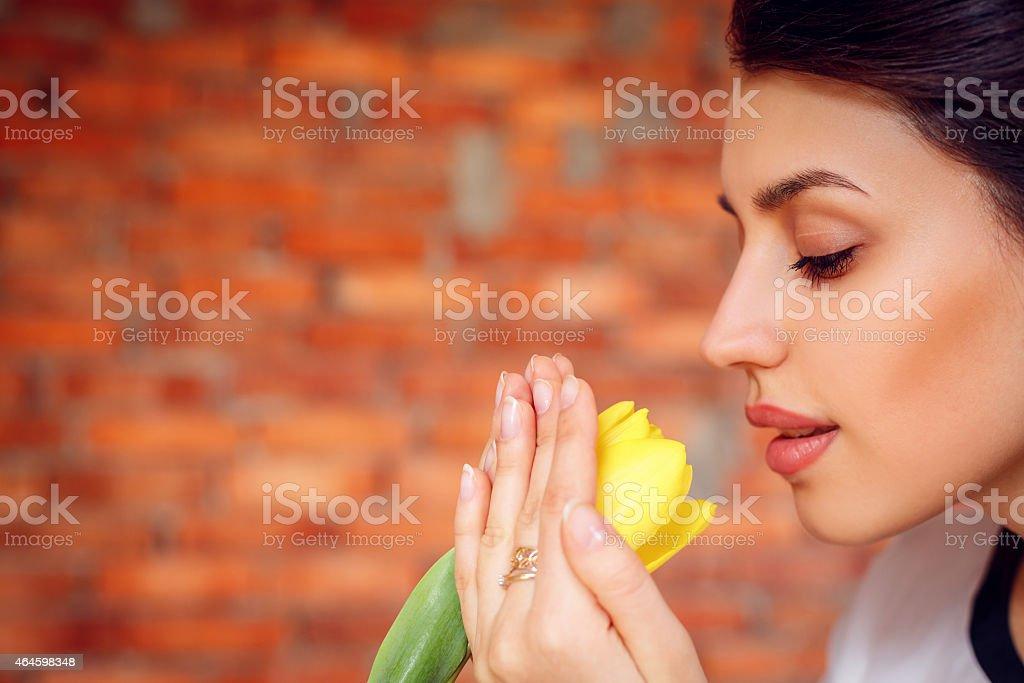 Beautiful girl with yellow tulips stock photo