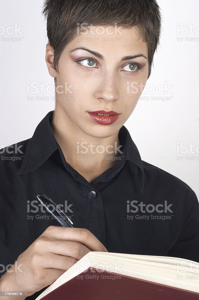 Beautiful girl writing in a book 01 royalty-free stock photo