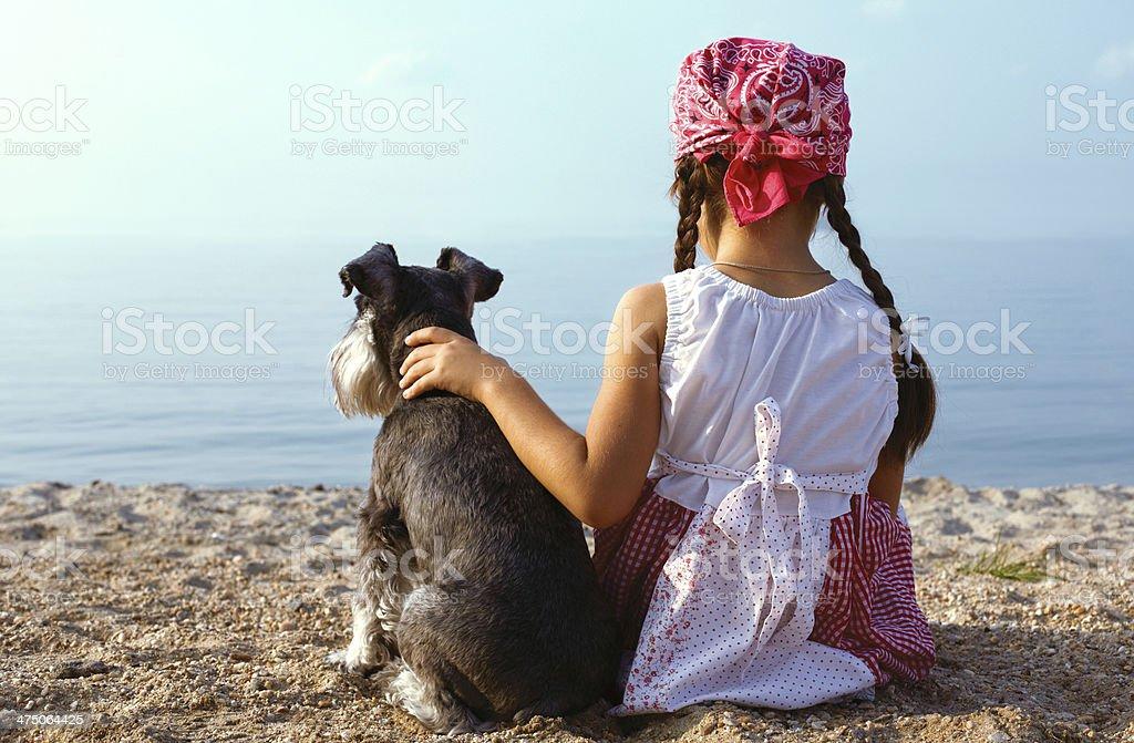 beautiful  girls embracing her dog stock photo