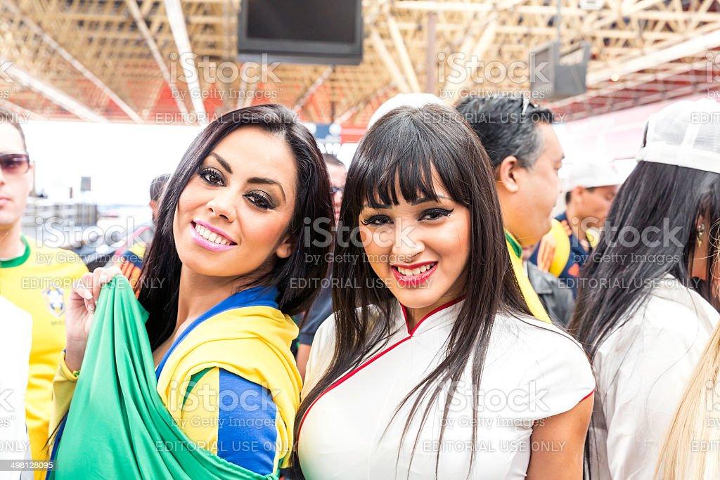Beautiful girls go to Arena Sao Paulo, Brazil stock photo