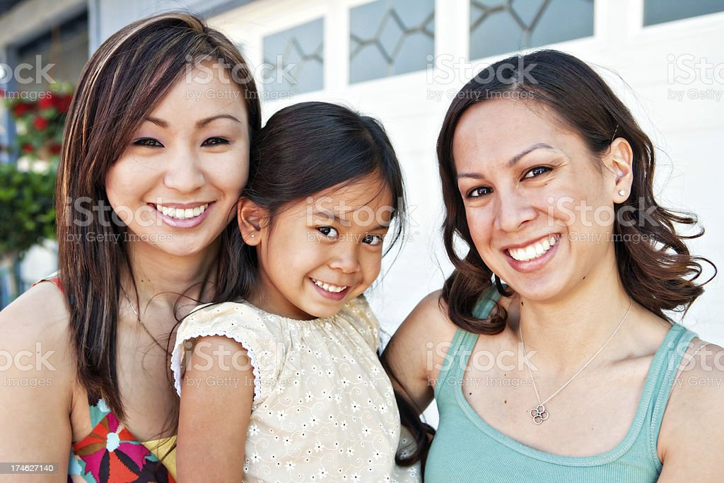 beautiful girls in front of house royalty-free stock photo