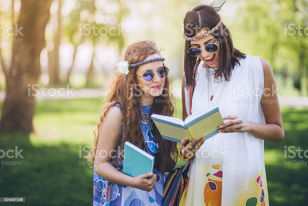 Beautiful girls of hippie in the field stock photo