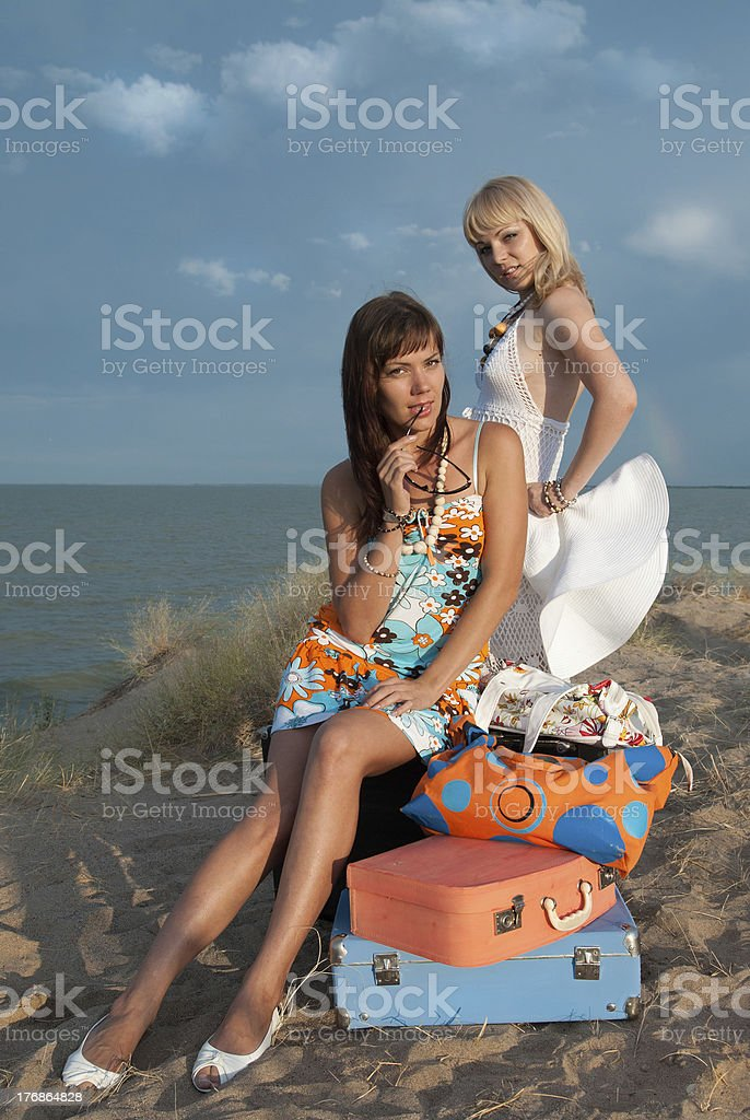 beautiful girls on the beach stock photo