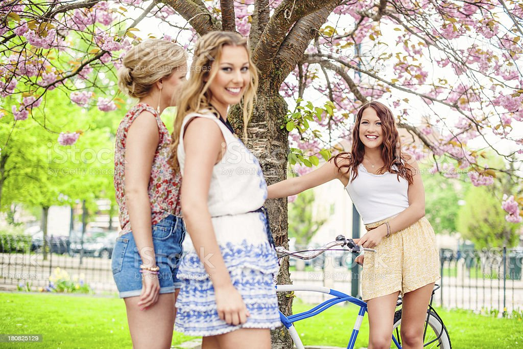 Beautiful girls with a bicycle royalty-free stock photo